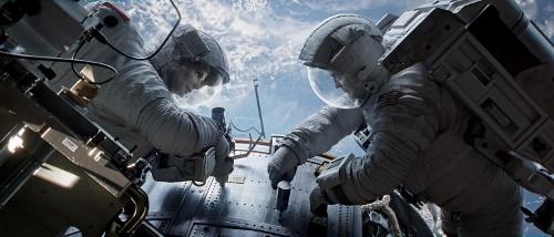 "Sandra Bullock and George Clooney in ""Gravity""."