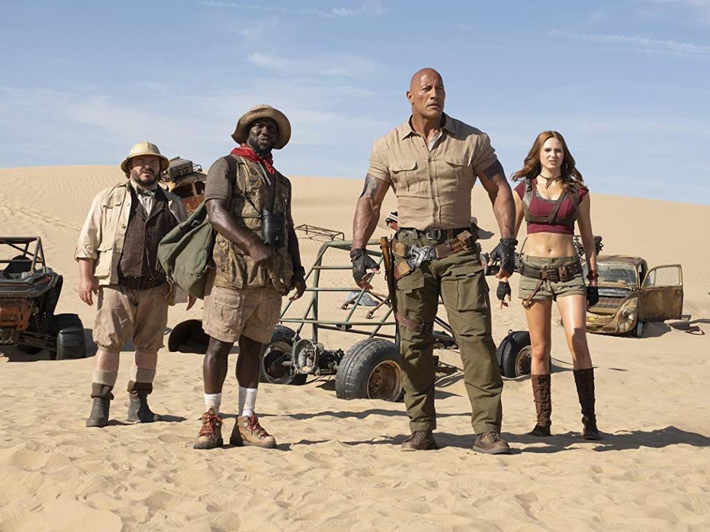 "L-R: Jack Black, Kevin Hart, Dwayne Johnson and Karen Gillan reprise their respective roles in ""Jumanji: The Next Level""."