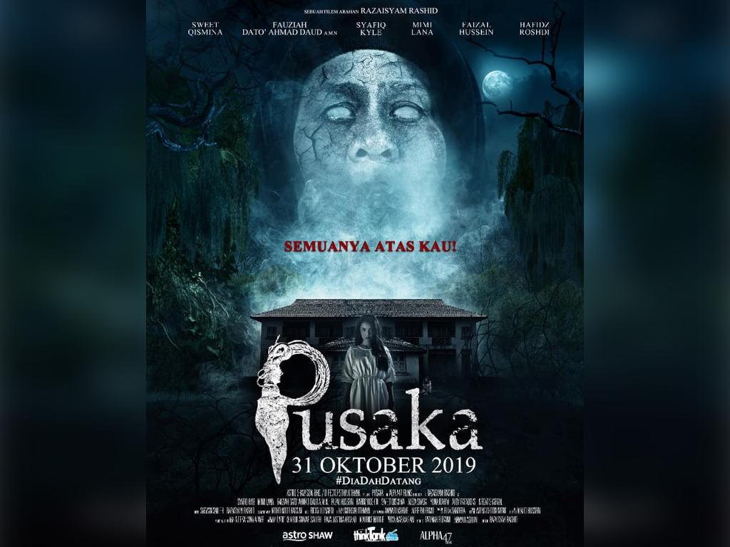 """Poster filem """"Pusaka"""" dengan tona warna filem yang memberi elemen seram."""
