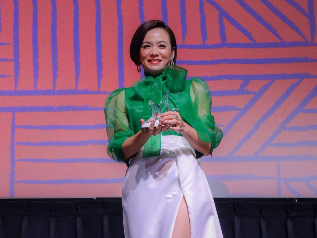 Malaysian actress Yeo Yann Yann poses with her Inspiring Woman in Film Award.