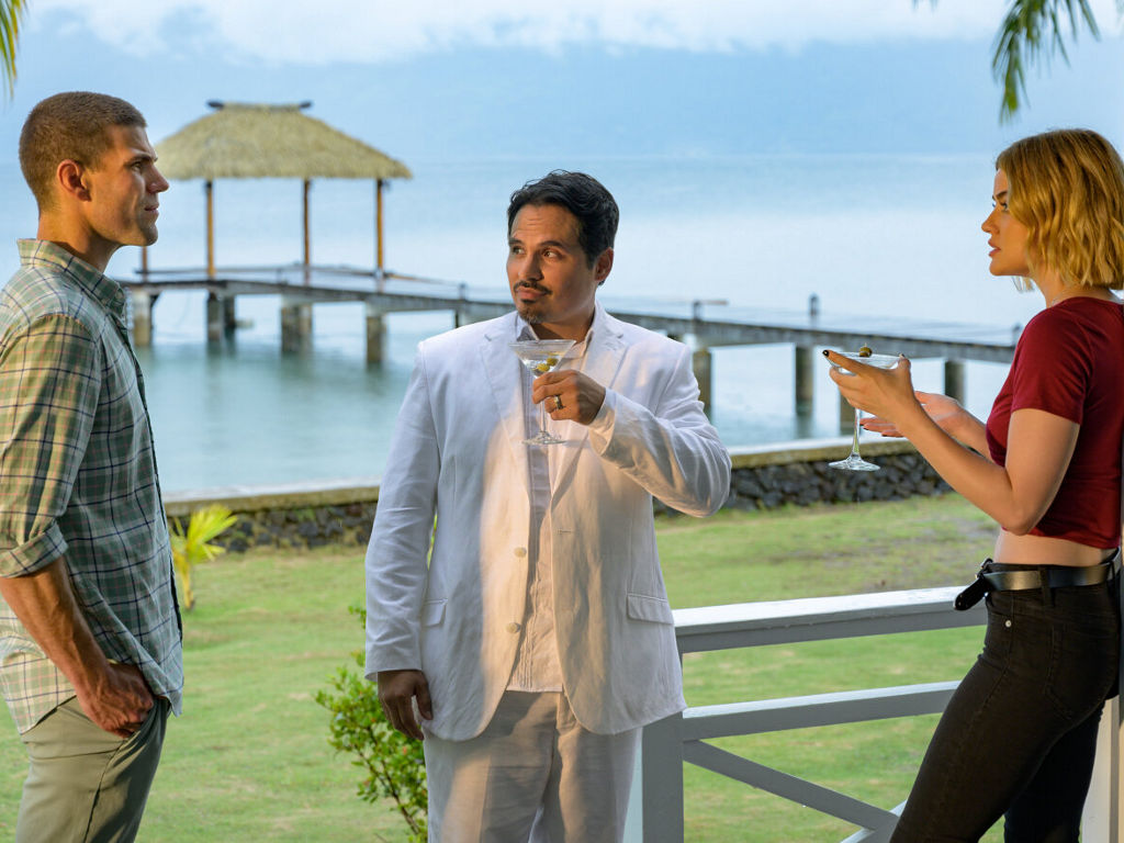 """Michael Pena (middle) plays the mysterious Mr. Roarke in the big-screen version of """"Fantasy Island""""."""