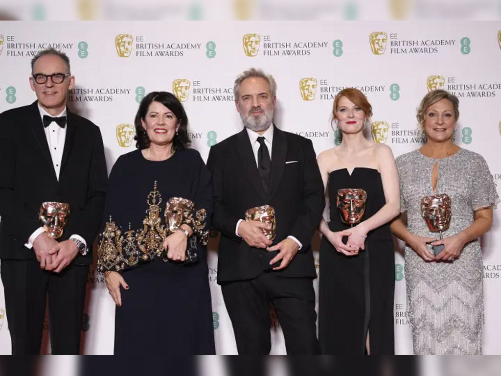 "The ""1917"" team, Callum McDougall, Pippa Harris, Sam Mendes, Krysty Wilson-Cairns and Jayne-Ann Tenggren, posing with their awards for Outstanding British Film."