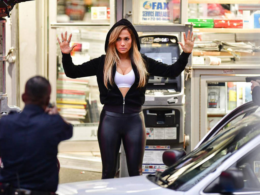 """Jennifer Lopez is in trouble with the law thanks to her role in """"Hustlers""""."""