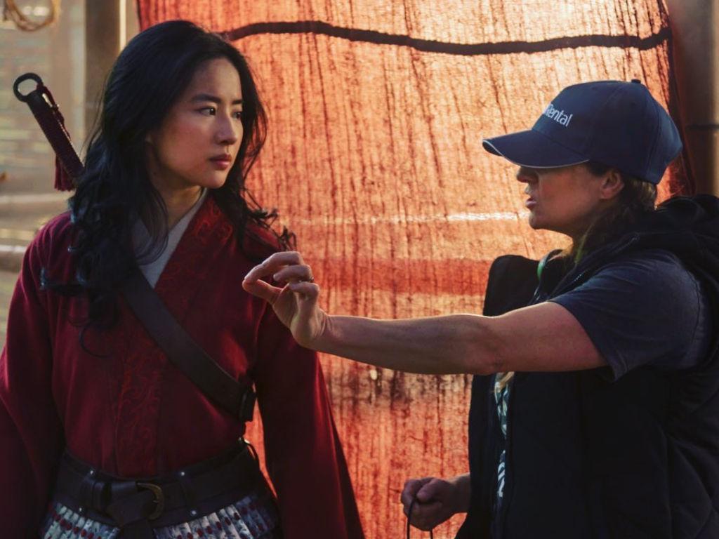 Crystal Liu seen on set as Mulan with director Niki Caro.