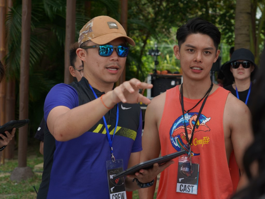 """Director Adrian Teh and actor Henley Hii on the set of """"Pasal Kau""""."""