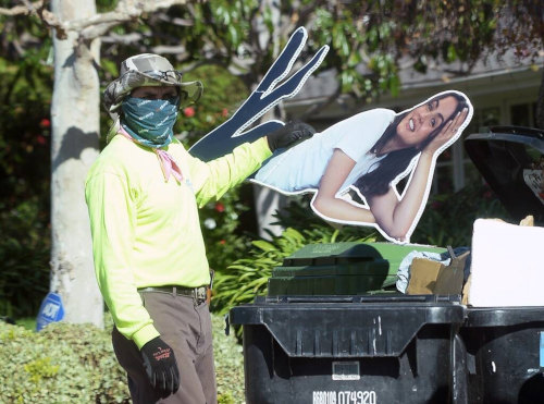 T'was a messy breakup when the gardener had to fit the Ana cardboard cutout into the trash bin