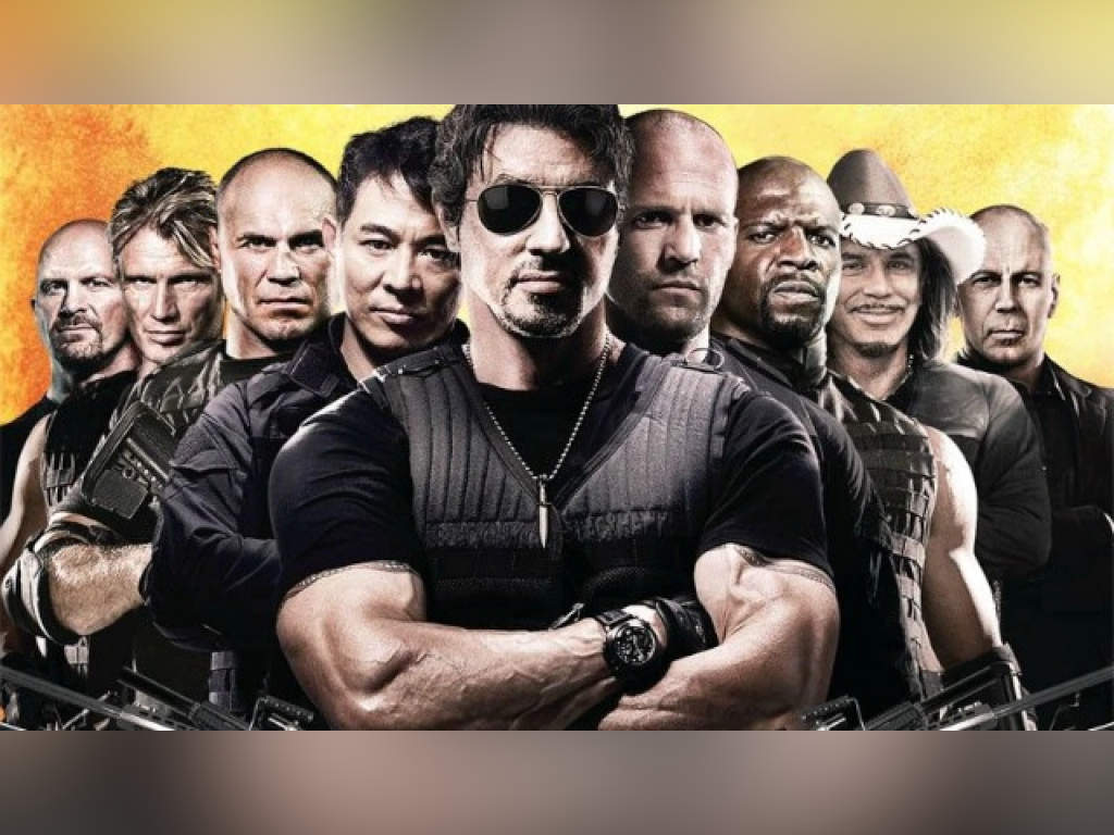 Expendables team leader, Barney Ross, with his band of men who leave a slew of explosive mayhem behind them.
