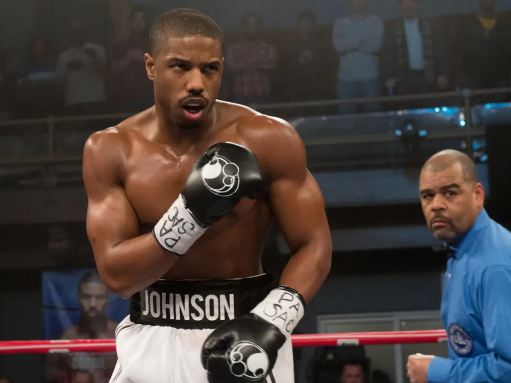 Michael B. Jordan played Adonis Creed, son of Apollo Creed, where he trained under Rocky Balboa in