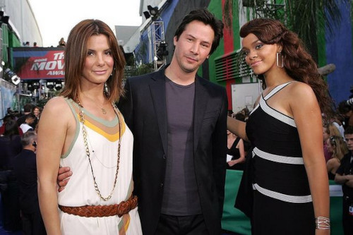 With 'Speed' co-star Keanu Reeves, and Rihanna